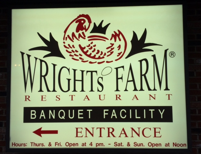 The sign for Wright's Farm uses an egg in the place of an apostrophe.
