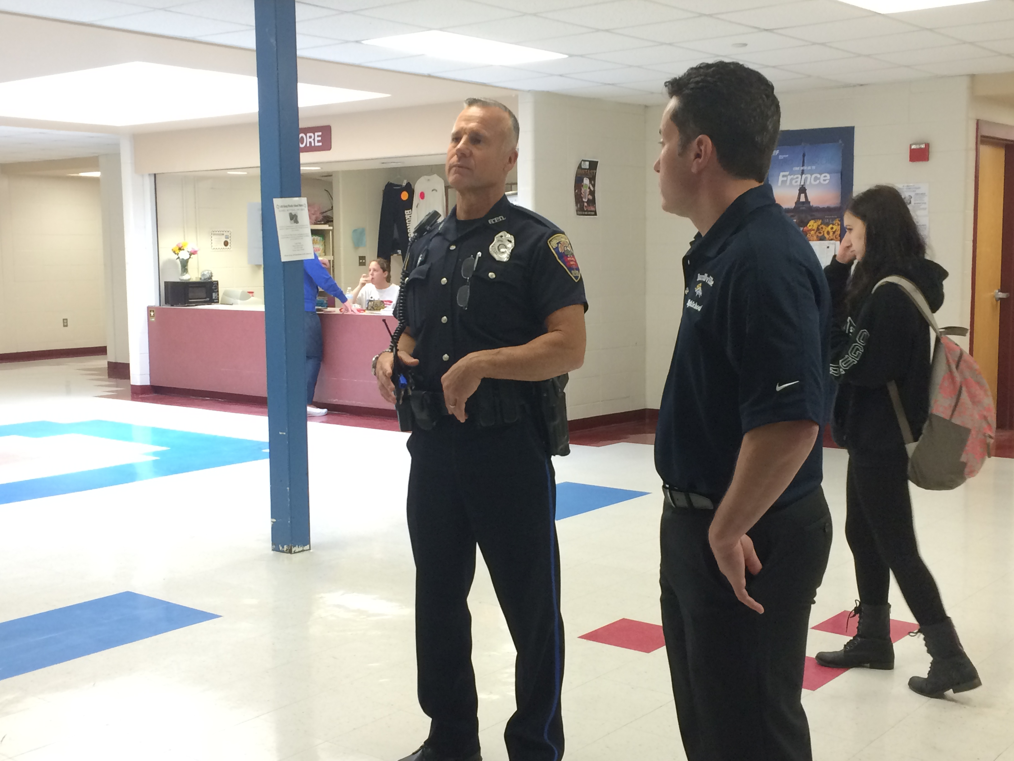 Resource Officer David Beauchemin with Assistant Principal Dave Alba in a hallway at Burrillville High School.