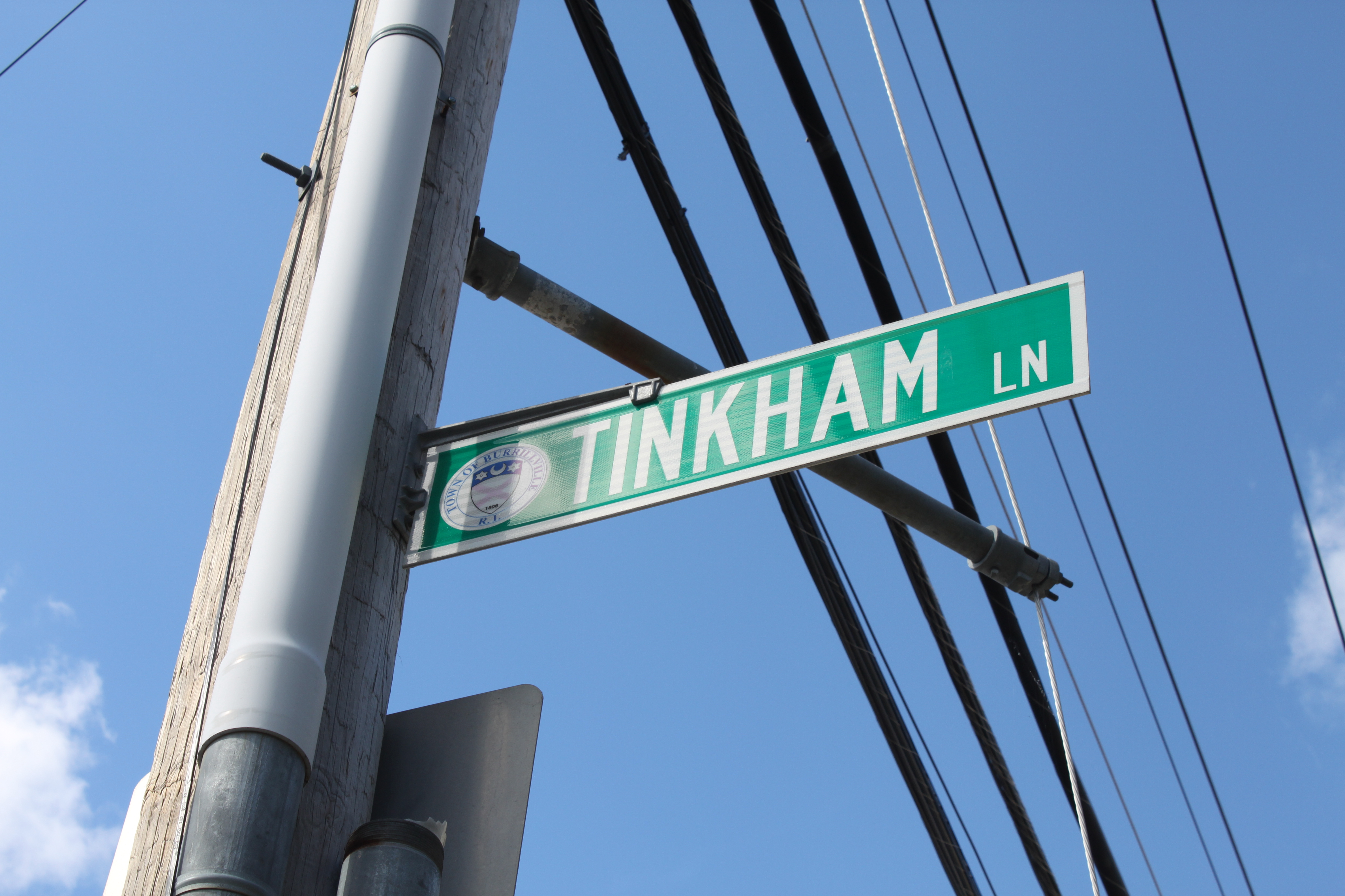 Tinkham Lane, named for William Tinkham, a mill owner, runs from the Clocktower apartments, through the parking lot, and meets Main St.