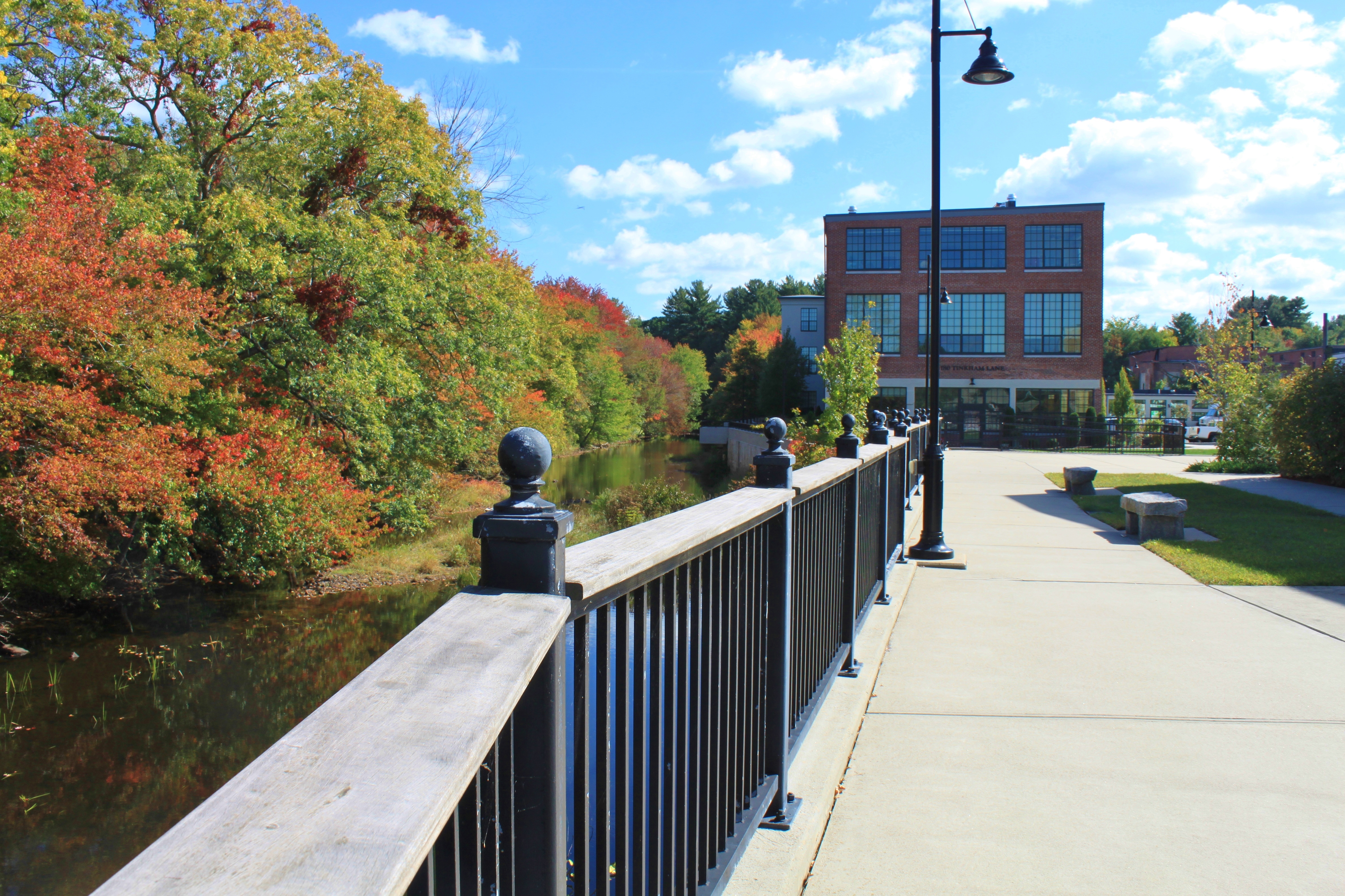 River walk, next to the Jesse M. Smith Memorial Library, looking ahead to the newly redeveloped Clocktower Apartments.