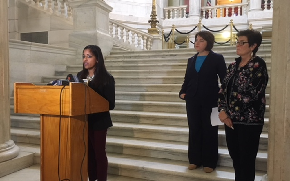 Mohanty (left), joined by Goldin and DeBare, speaks during a Statehouse news conference.